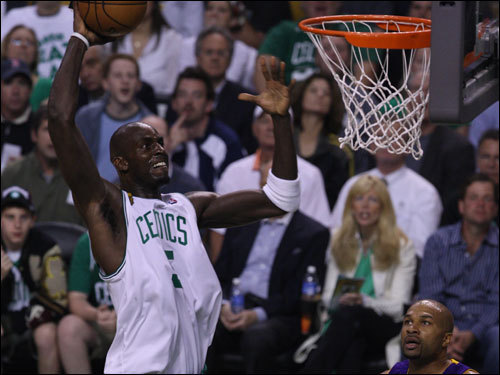 Garnett reacted to a hard dunk in the first quarter.