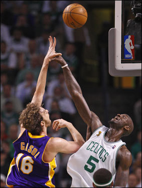 Pau Gasol (left) shot over Keving Garnett (right) during the game.
