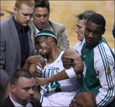Paul Pierce reacted as he was carried off the court in the third quarter.