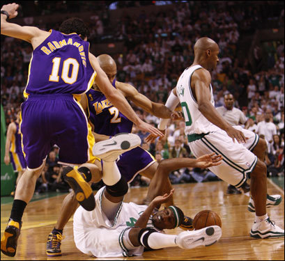 Celtics forward James Posey (41) dove for the ball in the second quarter.