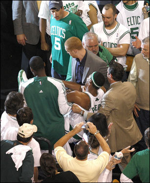 Stunned Celtics fans looked on as Boston's captain Paul Pierce was carried into the locker room by teammates in the third quarter.