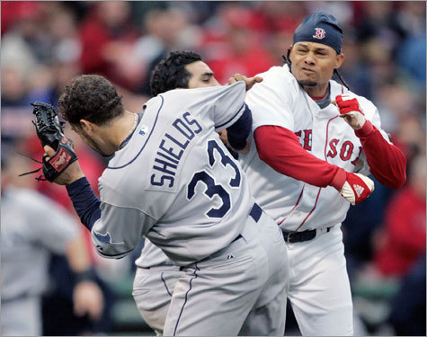 Coco Crisp was hit on the right hip by James Shields, prompting a benches-clearing brawl. Crisp dropped his bat, charged the mound, ducked a wild right by Shields before throwing a few punches that may have grazed Shields before being tackled to the ground by catcher Dioner Navarro. The tempers carried over from an earlier game, when Tampa Bay manager Joe Maddon said Crisp's slide 'intentionally' tried to hurt somebody. Eight players received suspensions for the roles in the melee.