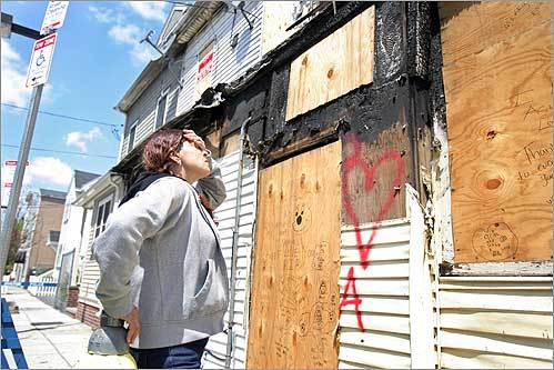 Anna Reisopoulos visited the burned-out South Boston row house where her daughters, Acia and Sophia Johnson, ages 14 and 3, died in an April fire allegedly set by Reisopoulos's lover.
