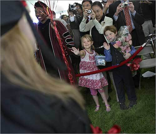 Seven-year-old twins Lyle Max and Melissa Spencer waived to their big sister, Emily, who was graduating from Wellesley College. The family is from St. Augustine, Fla.