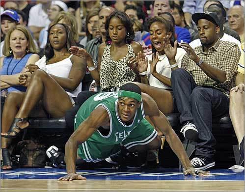 Celtics guard Rajon Rondo ended up in the front row after some aggressive fourth quarter defense in Game 6 against the Pistons.