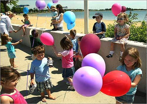 Children with St. Brigid's preschool in South Boston enjoyed one of their last days of school before summer vacation with a field trip to the nearby beach on Pleasure Bay, where they were given helium balloons.
