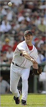 Closer Jonathan Papelbon threw to first in time to get Mariner Jeremy Reed out at first in the ninth inning.