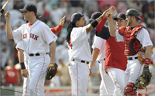 Red Sox players (from left) Jonathan Papelbon, Manny Ramirez, Bartolo Colon, and Jason Varitek celebrated beating the Seattle Mariners and winning the series.