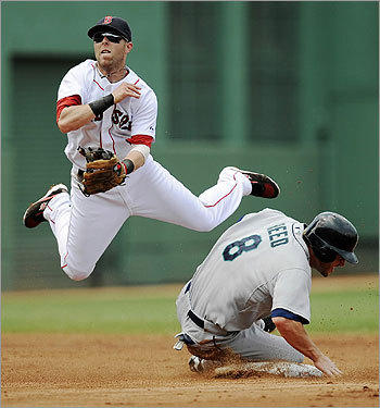 Dustin Pedroia leaped to avoid a collision with Jeremy Reed at second base.
