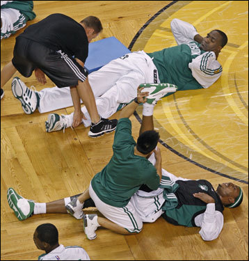 Kendrick Perkins (above) and Paul Pierce stretched their injured legs prior to Game 2.