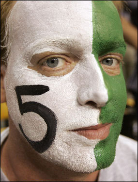 A Kevin Garnett fan with a painted face looked on before the game.