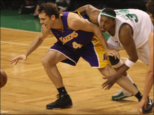 Lakers forward Luke Walton (left) and Celtics forward Paul Pierce (right) went after a loose ball in the first half.