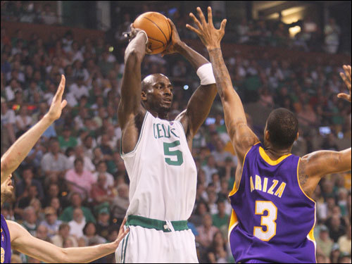 Kevin Garnett (left) looked to pass over Trevor Ariza (right) during first half action.