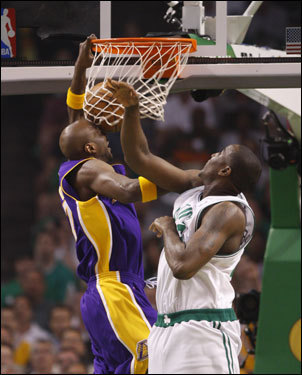 Lakers forward Lamar Odom (left) went in for the dunk over Kendrick Perkins (right) in the first half.