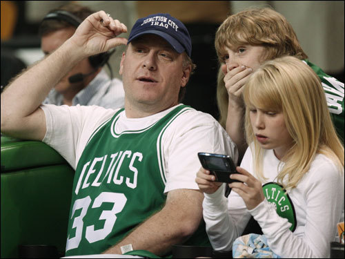 Red Sox pitcher Curt Schilling sat courtside in a Larry Bird jersey for Game 2 at the TD Banknorth Garden.