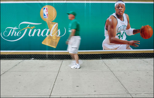 Fans walked past a Paul Pierce banner outside the TD Banknorth Garden.