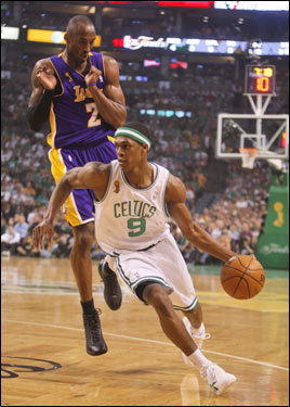 Celtics point guard Rajon Rondo (9) dribbled around Kobe Bryant (8) in the first half.
