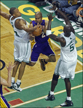 P.J. Brown (left) blocked the shot of Laker guard Derek Fisher (center) during the game.