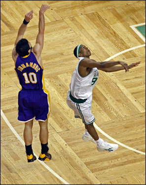 Rajon Rondo (right) hung in the air after a block of Vladimir Radmanovic (left).