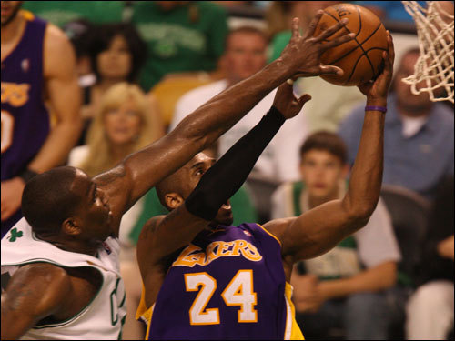 Kobe Bryant laid the ball in over Kendrick Perkins (left).