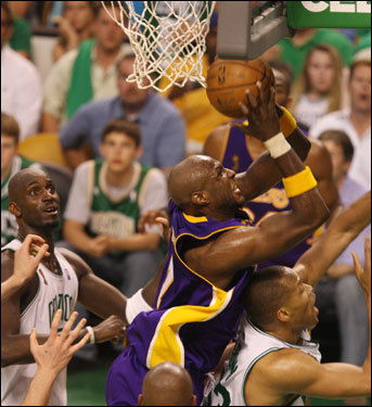 Lamar Odom grabbed an offensive rebound during the game.