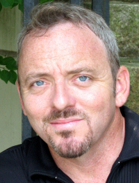 Boston author Dennis Lehane said he'll never return to the book-a-year 'hamster wheel' pace.
