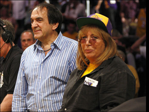 Director Penny Marshall (right) looked on before the game.
