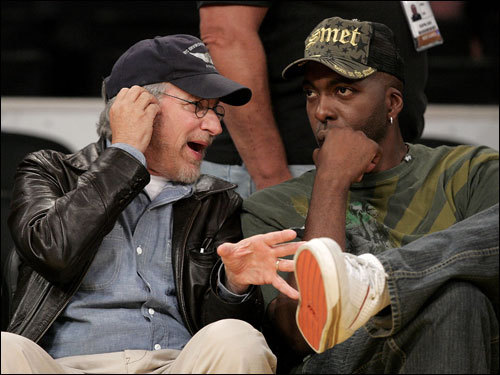 Director Steven Spielberg (left) and former NBA player John Salley (right) talked before the start of Game 3.