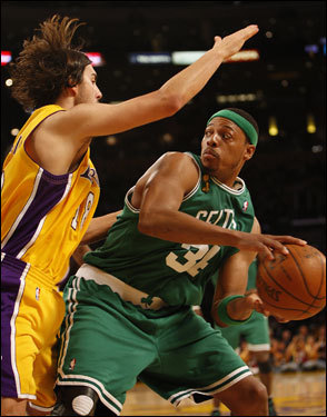 Paul Pierce (right) looked to pass as he was defended by Sasha Vujacic in the first half.