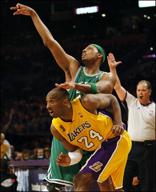 Paul Pierce (34) launched a shot over the defense of Kobe Bryant (24).