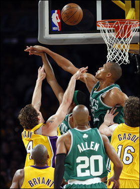 Lakers forward Luke Walton (left) had his shot blocked by Celtics center P.J. Brown.