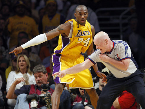 Kobe Bryant (left) discussed a call with referee Joey Crawford (right) during second half action.