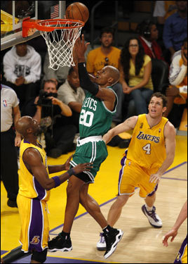 Celtics guard Ray Allen laid in a basket during the second half.