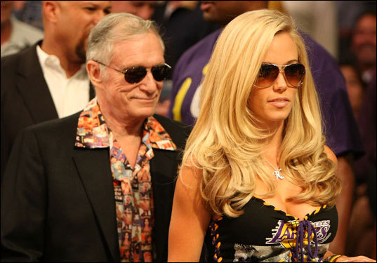 Girl next door Kendra Wilkinson (right) and Hugh Hefner were on hand for Game 3 at the Staples Center.