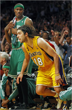 Sasha Vujacic crashed Boston's bench (much to James Posey's chagrin) after a three.