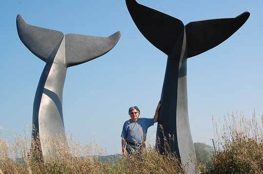 Jim Sardonis stands by his famous whale tail sculpture ''Reverence,'' which stands off Interstate 89 near Burlington, Vt. Sardonis's sculpture of a polar bear family will be unveiled at the Andover library Saturday.