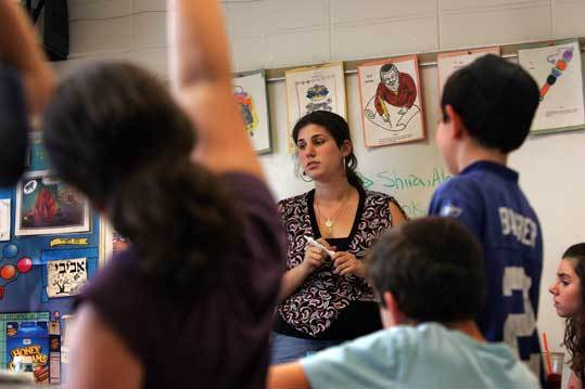 Brenda Edelman leads a Tuesday afternoon Hebrew school class at Newton's Congregation Mishkan Tefila, where real-world activities are emphasized in an effort to keep students interested.
