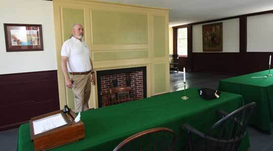 Robert Childs, Historical Society of Watertown project coordinator, tours the Fowle House's meeting room, looking as it did when the rebel colony's executive council met there in 1775.