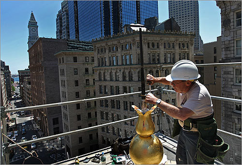 Freddy Benoit with Oak Roofing Company soldered the top of the weather vane on top of the Old State House dome. The weather vane, which is usually perched at 102 feet, was most likely an early work by the 18th century coppersmith Shem Drowne.