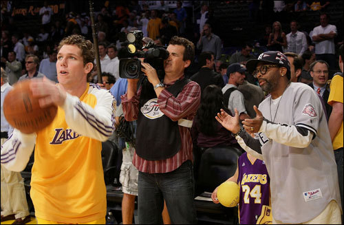 Laker forward Luke Walton (left) warmed up as director Spike Lee (right) looked on prior to the start of Game 4 of the NBA Finals at the Staples Center in Los Angeles, CA.