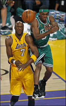 Lakers forward Lamar Odom (left) bumped Celtics point guard Rajon Rondo early in the first half. Rondo's mobility was limited due to a bone bruise in his left ankle.
