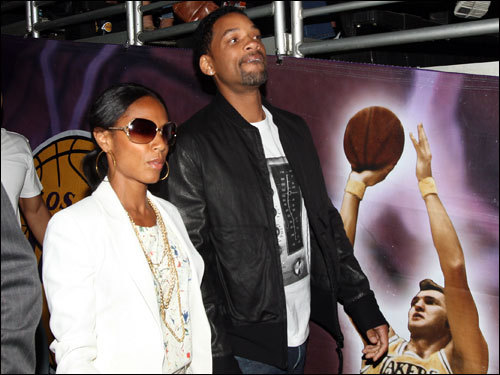 Will Smith (right) and wife Jada Pinkett-Smith were on hand for Game 4.