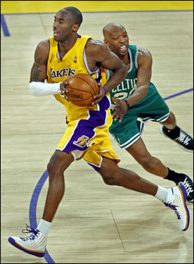 Sam Cassell (right) fouled Kobe Bryant as the Laker headed up the floor. Bryant shot just 6 free throws in Game 4 after heading to the line 18 times in the previous game.