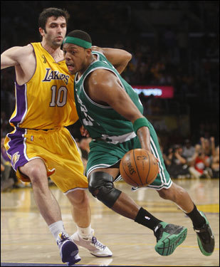 Paul Pierce (right) took the ball to the basket while being defended by Lakers forward Vladimir Radmonovic.