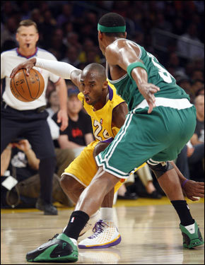 Kobe Bryant (left) tried to drive past the defense of Paul Pierce in the second half. Bryant scored just 17 points, well below the 36 he posted in Game 3.