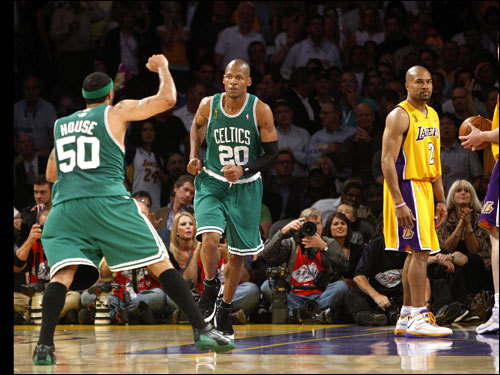 Eddie House (50) celebrated with Ray Allen after Allen's crucial late-game basket. Leading 96-91 with 16.4 seconds remaining, the Celtics could smell victory.