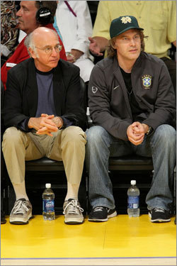 Actor/comedian Larry David (left) looked on during Game 4 of the Finals.