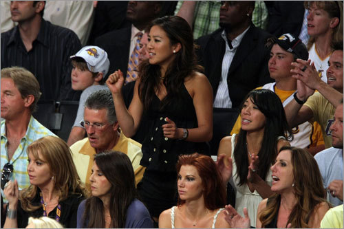 Figure skating star Michelle Kwan rose from her seat to cheer at Game 4 of the NBA Finals.