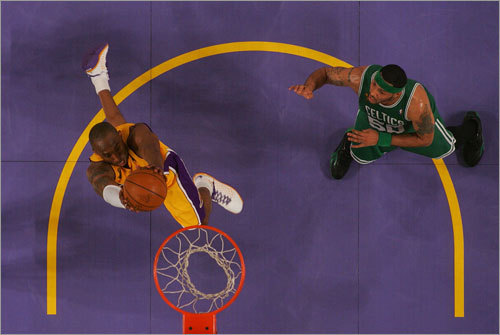 Things looked good for the Celtics, but after an official timeout, the Lakers came out on a roll, with a 20-footer from Kobe Bryant and a layup from Lamar Odom answered only by two points from Kevin Garnett. Then Paul Pierce toppled to the floor as the Lakers threw the ball up the court to Bryant for this slam dunk. The Celtics quickly called a timeout, but Pierce had only turned his ankle, and would play on.