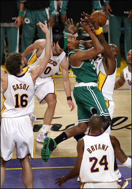 Paul Pierce (center) drove into the teeth of the Laker defense.